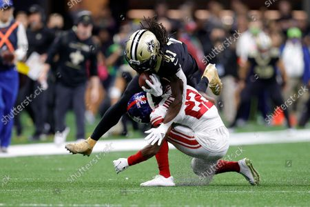 New Orleans Saints running back Alvin Kamara (41) is tackled by New York Giants cornerback Adoree' Jackson (22) during an NFL football game, in New Orleans