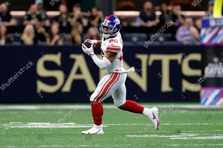 New York Giants running back Saquon Barkley (26) runs the ball during an NFL football game against the New Orleans Saints, in New Orleans