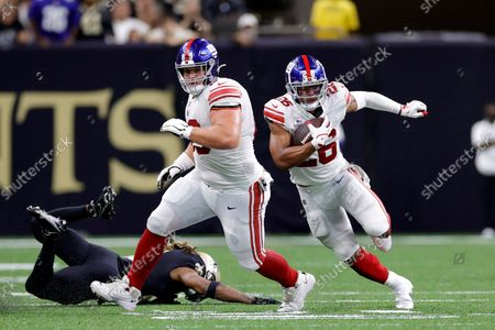 New York Giants running back Saquon Barkley (26) and center Billy Price (69) in action during an NFL football game against the New Orleans Saints, in New Orleans