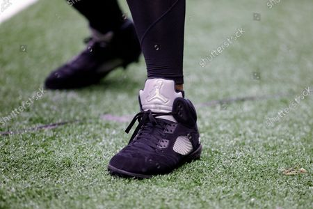 Detailed view of New Orleans Saints defensive end Cameron Jordan's cleats (94) before an NFL football game against the New York Giants, in New Orleans