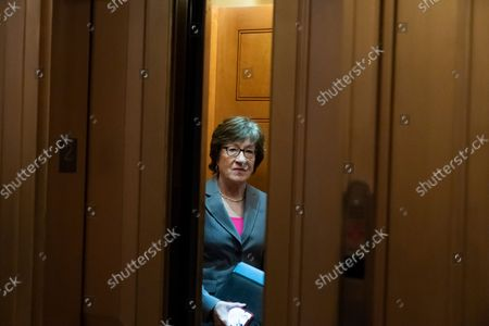 Sen. Susan Collins, R-Maine, stands in an elevator as she departs, on Capitol Hill, in Washington. The Senate has dodged a U.S. debt disaster by approving legislation to lift the federal limit on new borrowing by nearly a half-trillion dollars