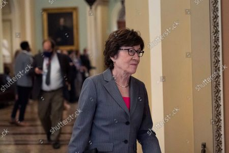 Sen. Susan Collins, R-Maine, walks from a policy luncheon on Capitol Hill, in Washington