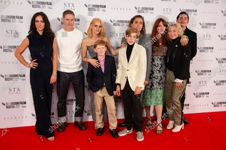 Amy Manson, from left, Sean Harris, Kristen Stewart, Freddie Spry, Jacki Nielen, Jack Farthing, Elizabeth Berrington, Stella Gonet and James Harkness pose for photographers upon arrival at the premiere of the film 'Spencer' during the 2021 BFI London Film Festival in London