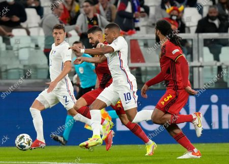 France's Benjamin Pavard, left, Kylian Mbappe and Belgium's Jason Denayer, right, race for the ball during the UEFA Nations League semifinal soccer match between Belgium and France at the Juventus stadium, in Turin, Italy