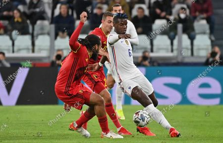 Belgium's Jason Denayer and France's Paul Pogba fight for the ball during a soccer game between Belgian national team Red Devils and France, the semi-finals of the Nations League, in Torino, Italy, on Thursday 07 October 2021.