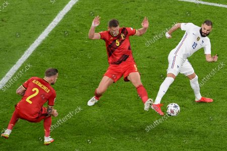 Italy's Leonardo Bonucci, right, and Belgium's Jan Vertonghen battle for the ball as Belgium's Toby Alderweireld, left, watches during the UEFA Nations League semifinal soccer match between Belgium and France at the Juventus stadium, in Turin, Italy