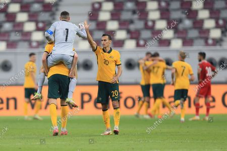 Australia's goalkeeper Mathew Ryan celebrates with Australia's Trent Sainsbury during a FIFA World Cup group B qualifying soccer match between Australia and Oman in Doha, Qatar