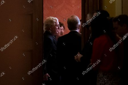 United States Senate Minority Leader Mitch McConnell (Republican of Kentucky), left, United States Senator Susan Collins (Republican of Maine), center, and United States Senator Roy Blunt (Republican of Missouri), right, are seen through the doorway of The Strom Thurmond Room at the US Capitol as Senate Republicans meet behind closed doors to discuss the debt ceiling vote at the U.S. Capitol in Washington, DC,. Senate Democrats and Republicans have reached a deal to temporarily raise the debt ceiling through early December.