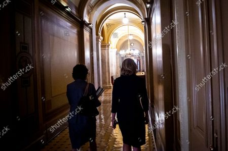 United States Senator Susan Collins (Republican of Maine), left, and United States Senator Lisa Murkowski (Republican of Alaska), right, walk through the US Capitol following a meeting between Senate Republicans behind closed doors to discuss the debt ceiling vote at the U.S. Capitol in Washington, DC,. Senate Democrats and Republicans have reached a deal to temporarily raise the debt ceiling through early December.