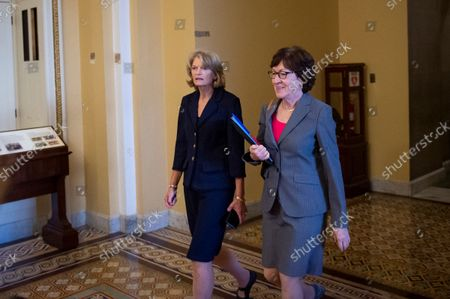 United States Senator Lisa Murkowski (Republican of Alaska), left, and United States Senator Susan Collins (Republican of Maine) walk through the US Capitol following a meeting between Senate Republicans behind closed doors to discuss the debt ceiling vote at the U.S. Capitol in Washington, DC,. Senate Democrats and Republicans have reached a deal to temporarily raise the debt ceiling through early December.