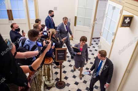 United States Senator John Thune (Republican of South Dakota) and United States Senator Susan Collins (Republican of Maine) talk with reporters following a meeting between Senate Republicans behind closed doors to discuss the debt ceiling vote at the U.S. Capitol in Washington, DC,. Senate Democrats and Republicans have reached a deal to temporarily raise the debt ceiling through early December.