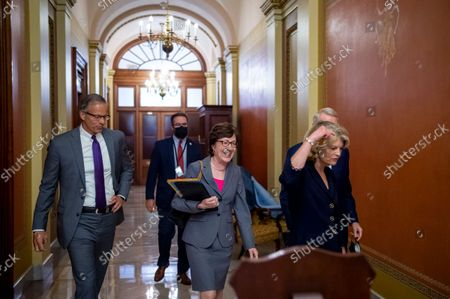 United States Senator John Thune (Republican of South Dakota), left, United States Senator Lisa Murkowski (Republican of Alaska), second from left, United States Senator Susan Collins (Republican of Maine), second from right, and United States Senator Rob Portman (Republican of Ohio), right, following a meeting between Senate Republicans behind closed doors to discuss the debt ceiling vote at the U.S. Capitol in Washington, DC,. Senate Democrats and Republicans have reached a deal to temporarily raise the debt ceiling through early December.