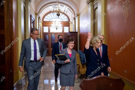 Stock Image of United States Senator John Thune (Republican of South Dakota), left, United States Senator Lisa Murkowski (Republican of Alaska), second from left, United States Senator Susan Collins (Republican of Maine), second from right, and United States Senator Rob Portman (Republican of Ohio), right, following a meeting between Senate Republicans behind closed doors to discuss the debt ceiling vote at the U.S. Capitol in Washington, DC,. Senate Democrats and Republicans have reached a deal to temporarily raise the debt ceiling through early December.