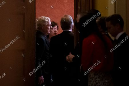 Stock Picture of United States Senate Minority Leader Mitch McConnell (Republican of Kentucky), left, United States Senator Susan Collins (Republican of Maine), center, and United States Senator Roy Blunt (Republican of Missouri), right, are seen through the doorway of The Strom Thurmond Room at the US Capitol as Senate Republicans meet behind closed doors to discuss the debt ceiling vote at the U.S. Capitol in Washington, DC,. Senate Democrats and Republicans have reached a deal to temporarily raise the debt ceiling through early December.