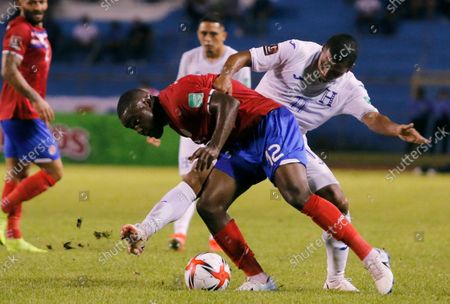 Costa Rica's Joel Campbell (12) controls the ball against Honduras' Diego Rodriguez during a qualifying soccer match for the FIFA World Cup Qatar 2022 in San Pedro Sula, Honduras