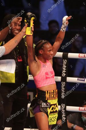 Stock Image of JAMIE MITCHELL (California, USA) celebrates after her win over SHANNON COURTENAY (Watford, England) after their WBA Bantamweight World Championship contest; M&S Bank Arena, Liverpool, England; Matchroom Boxing, Liam Smith versus Anthony Fowler.