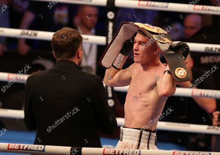Stock Image of LIAM SMITH (Liverpool, England) speaks with promoter Eddie Hearn after his win over ANTHONY FOWLER (Liverpool, England) for the WBA International Super-Welterweight Title; M&S Bank Arena, Liverpool, England; Matchroom Boxing, Liam Smith versus Anthony Fowler.