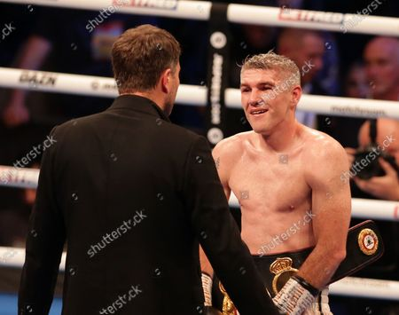 Stock Photo of LIAM SMITH (Liverpool, England) speaks with promoter Eddie Hearn after his win over ANTHONY FOWLER (Liverpool, England) for the WBA International Super-Welterweight Title; M&S Bank Arena, Liverpool, England; Matchroom Boxing, Liam Smith versus Anthony Fowler.