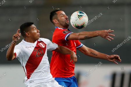 Stock Picture of Peru's Edison Flores (L) in action against Chile's Mauricio Isla, during a soccer match between Peru and Chile amid the South American qualifiers for the Qatar 2022 World Cup at the National Stadium in Lima, Peru, 07 October 2021.
