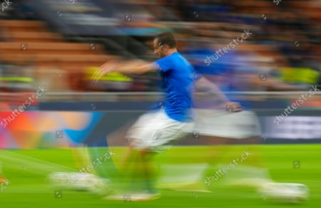 Italy's Leonardo Bonucci warms up prior to the start of the UEFA Nations League semifinal soccer match between Italy and Spain at the San Siro stadium, in Milan, Italy