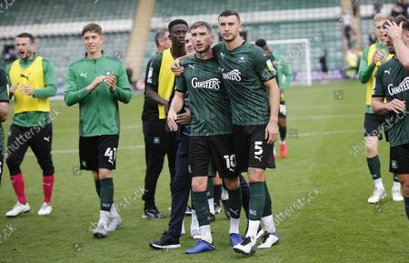 final whistle delight for Danny Mayor of Plymouth Argyle and James Wilson of Plymouth Argyle during the Sky Bet League 1 match between Plymouth Argyle and Burton Albion on Saturday 9th October 2021, Home Park, Plymouth, Devon - Photo: Dave Rowntree/PPAUK