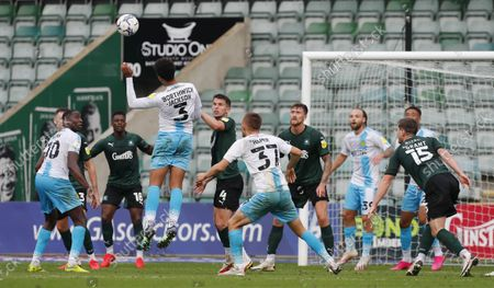 Jordan Houghton of Plymouth Argyle puts Cameron Borthwick Jackson of Burton Albion under pressure during the Sky Bet League 1 match between Plymouth Argyle and Burton Albion on Saturday 9th October 2021, Home Park, Plymouth, Devon - Photo: Dave Rowntree/PPAUK