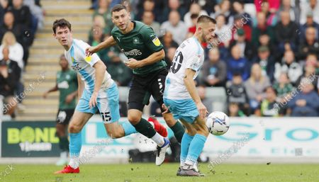 James Wilson of Plymouth Argyle battles for the ball with Charlie Lakin of Burton Albion during the Sky Bet League 1 match between Plymouth Argyle and Burton Albion on Saturday 9th October 2021, Home Park, Plymouth, Devon - Photo: Dave Rowntree/PPAUK