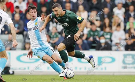 James Wilson of Plymouth Argyle battles for the ball with Thomas O Connor of Burton Albion during the Sky Bet League 1 match between Plymouth Argyle and Burton Albion on Saturday 9th October 2021, Home Park, Plymouth, Devon - Photo: Dave Rowntree/PPAUK