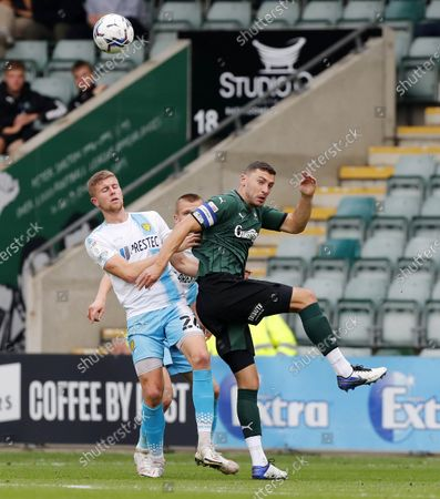James Wilson of Plymouth Argyle challenges for the ariel ball with Ryan Leak of Burton Albion during the Sky Bet League 1 match between Plymouth Argyle and Burton Albion on Saturday 9th October 2021, Home Park, Plymouth, Devon - Photo: Dave Rowntree/PPAUK