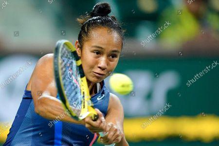 Leylah Fernandez returns shot to Alize Cornet, or France, at the BNP Paribas Open tennis tournament, in Indian Wells, Calif