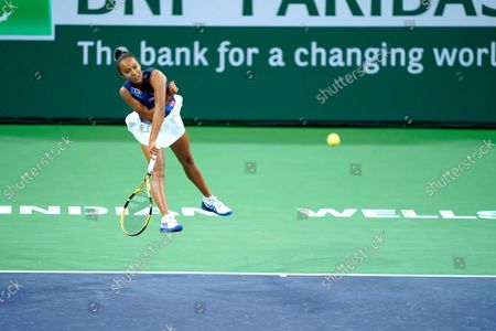 Leylah Fernandez serves to Alize Cornet, or France, at the BNP Paribas Open tennis tournament, in Indian Wells, Calif