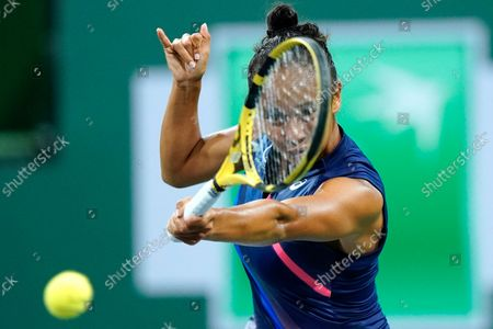 Leylah Fernandez returns shot to Alize Cornet, of France, at the BNP Paribas Open tennis tournament, in Indian Wells, Calif