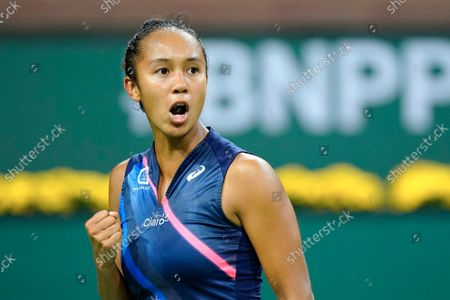 Leylah Fernandez celebrates winning a point over Alize Cornet, of France, at the BNP Paribas Open tennis tournament, in Indian Wells, Calif