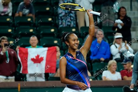 Leylah Fernandez celebrates after defeating Alize Cornet, of France, 6-2, 6-3 at the BNP Paribas Open tennis tournament, in Indian Wells, Calif