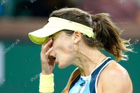 Alize Cornet, of France, reacts to losing a point to Leylah Fernandez at the BNP Paribas Open tennis tournament, in Indian Wells, Calif