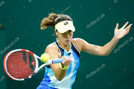 Stock Picture of Alize Cornet, of France, returns a shot to Leylah Fernandez at the BNP Paribas Open tennis tournament, in Indian Wells, Calif