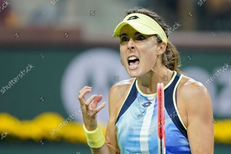 Stock Image of Alize Cornet, of France, reacts to losing a point to Leylah Fernandez at the BNP Paribas Open tennis tournament, in Indian Wells, Calif