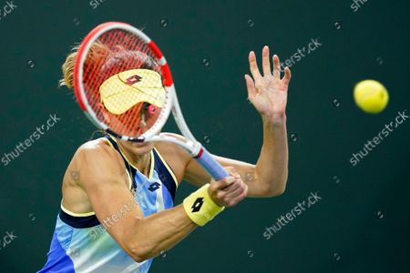 Stock Photo of Alize Cornet, of France, returns a shot to Leylah Fernandez at the BNP Paribas Open tennis tournament, in Indian Wells, Calif