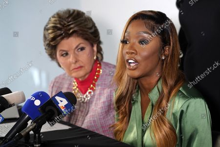 """Faith Rodgers, right, who testified recently at R. Kelly's criminal trial in New York, addresses reporters alongside her attorney Gloria Allred, at Allred's offices in Los Angeles. Rodgers addressed comments made by Bill Cosby's spokesperson, Andrew Wyatt, that Kelly was """"railroaded"""" and did not receive a fair trial"""