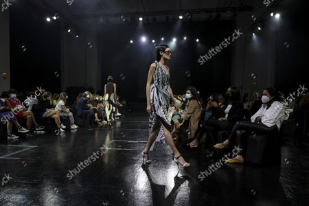 A model displays a creation by Portuguese fashion designer Luis Buchinho on the second day of the Lisbon Fashion Week 2021, at Capitolio in Lisbon, Portugal, 08 October 2021. The 57th ModaLisboa runs from 07 to 10 October 2021.