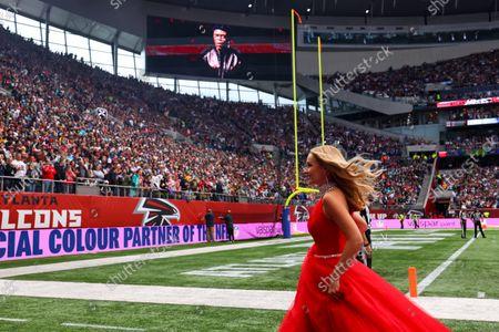 NFL UK Series, Atlanta Falcons versus New York Jets: Singer Katherine Jenkins leaves the field of play; Tottenham Hotspur stadium, London, England.