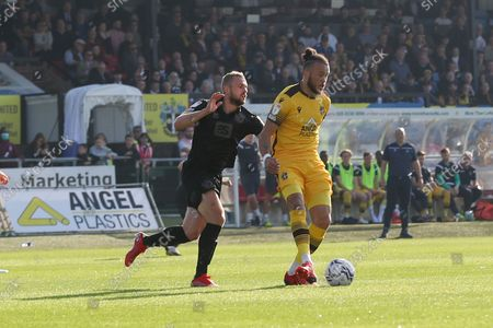Port Vale forward James Wilson (9) and Sutton United defender Joe Kizzi  (22)  during the EFL Sky Bet League 2 match between Port Vale and Rochdale at Vale Park, Burslem