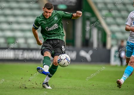 Plymouth Argyle defender James Wilson  (5) passes the ball forward  during the EFL Sky Bet League 1 match between Plymouth Argyle and Burton Albion at Home Park, Plymouth