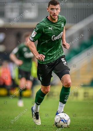 Plymouth Argyle defender James Wilson  (5) on the ball  during the EFL Sky Bet League 1 match between Plymouth Argyle and Burton Albion at Home Park, Plymouth