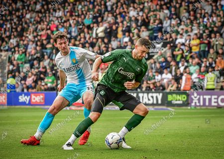 Plymouth Argyle defender James Wilson  (5) shields the ball  during the EFL Sky Bet League 1 match between Plymouth Argyle and Burton Albion at Home Park, Plymouth