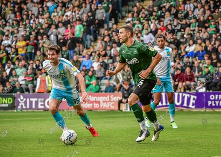 Plymouth Argyle defender James Wilson  (5) on the ball and looks for pass during the EFL Sky Bet League 1 match between Plymouth Argyle and Burton Albion at Home Park, Plymouth