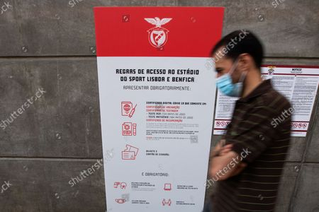 Stock Image of A man wearing mask waiting to vote for the new President of Sport Lisboa e Benfica , on October 9, 2021, at the Luz Stadium in Lisbon, Portugal.The Elections for the New President of Sport Lisboa e Benfica are held today. Former player Rui Costa is the main candidate and competes against Francisco Benitez.