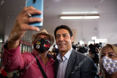 Stock Picture of Rui Costa, the candidate for the President of Sport Lisboa e Benfica takes pictures to the supporters, on October 9, 2021, at the Luz Stadium in Lisbon, Portugal.The Elections for the New President of Sport Lisboa e Benfica are held today. Former player Rui Costa is the main candidate and competes against Francisco Benitez.