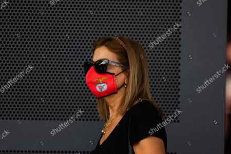 Stock Photo of A women wearing mask with the Benfica logo waiting to vote for the new President of Sport Lisboa e Benfica , on October 9, 2021, at the Luz Stadium in Lisbon, Portugal.The Elections for the New President of Sport Lisboa e Benfica are held today. Former player Rui Costa is the main candidate and competes against Francisco Benitez.