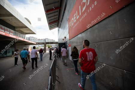 A man in the queue waiting to vote in the Benfica 10 shirt that was worn by Rui Costa when he was playing , on October 9, 2021, at the Luz Stadium in Lisbon, Portugal.The Elections for the New President of Sport Lisboa e Benfica are held today. Former player Rui Costa is the main candidate and competes against Francisco Benitez.